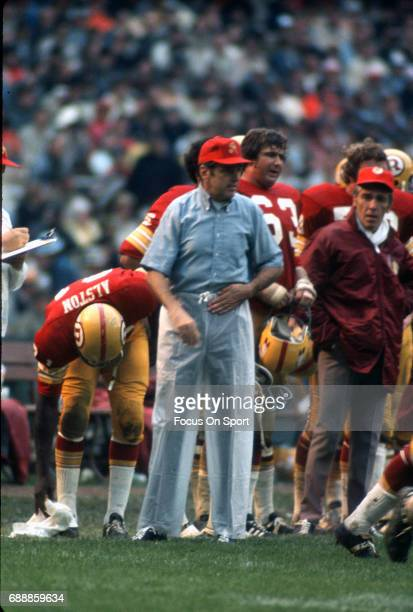 Head coach George Allen of the Washington Redskins looks on from the sidelines during an NFL football game circa 1971 at RFK Stadium in Washington DC...