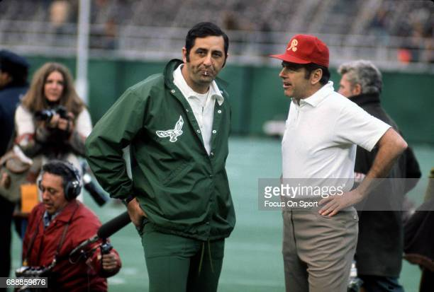 Head coach George Allen of the Washington Redskins talks with a Philadelphia Eagles coach prior to the start of an NFL football game circa 1972 at...