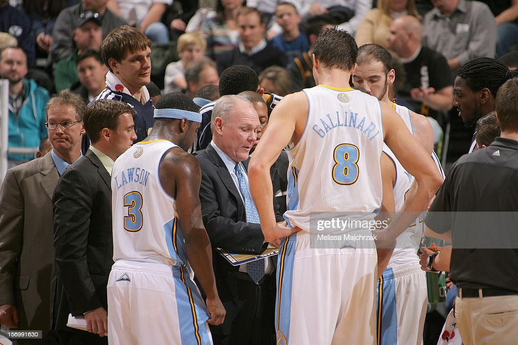 Head coach <a gi-track='captionPersonalityLinkClicked' href=/galleries/search?phrase=George+Karl&family=editorial&specificpeople=204519 ng-click='$event.stopPropagation()'>George Karl</a> and the Denver Nuggets plan the game during a timeout against the Utah Jazz at Energy Solutions Arena on November 26, 2012 in Salt Lake City, Utah.