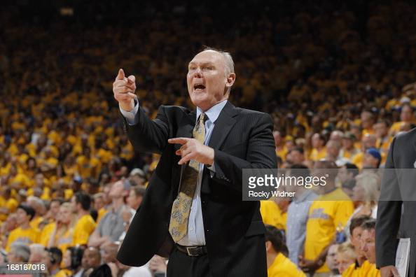 Head Coach George Karl of the Denver Nuggets instructs his players against the Golden State Warriors in Game Six of the Western Conference...
