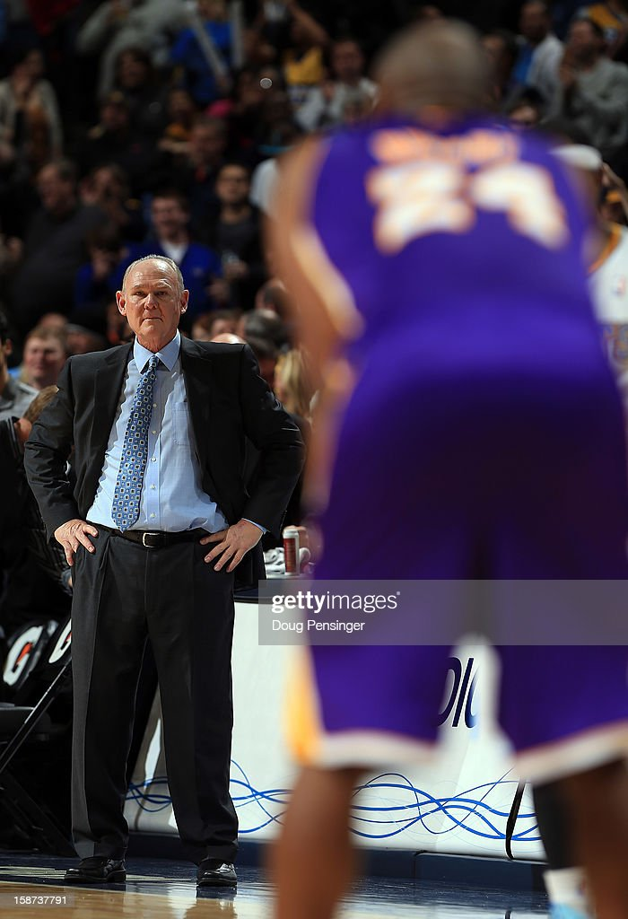Head coach George Karl of the Denver Nuggets leads his team against Kobe Bryant #24 and the Los Angeles Lakers at Pepsi Center on December 26, 2012 in Denver, Colorado. The Nuggets defeated the Lakers 126-114.