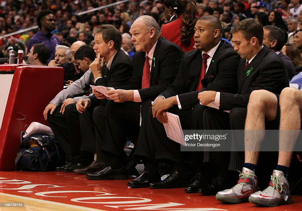 Head Coach George Karl of the Denver Nuggets (2nd from Left) looks on from the bench area during the NBA game at Staples Center on December 25, 2012 in Los Angeles, California. The Clippers defeated the Nuggets 112-100.