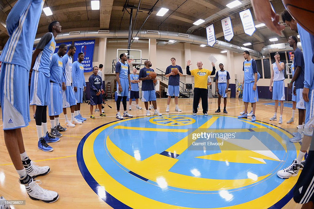 Head Coach <a gi-track='captionPersonalityLinkClicked' href=/galleries/search?phrase=George+Karl&family=editorial&specificpeople=204519 ng-click='$event.stopPropagation()'>George Karl</a> of the Denver Nuggets talks to his players during practice on October 24, 2012 at the Pepsi Center in Denver, Colorado.