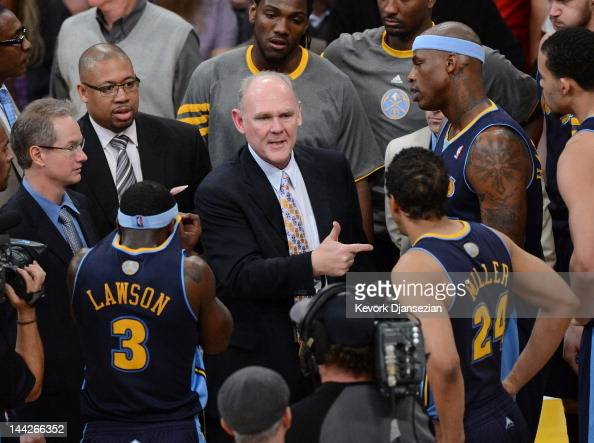 Head coach George Karl of the Denver Nuggets talks with his team during a timeout while taking on the Los Angeles Lakers in Game Seven of the Western...