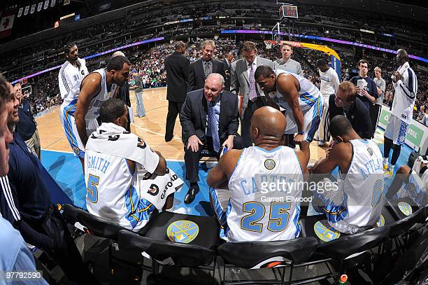 Head coach George Karl of the Denver Nuggets talks with his team during a time out against the Washington Wizards on March 16 2010 at the Pepsi...