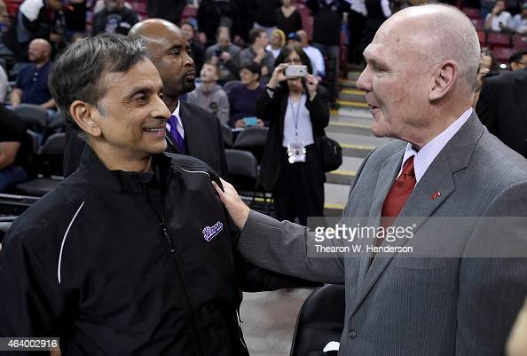 Head coach George Karl of the Sacramento Kings gets greeted by the owner Vivek Ranadive' prior to the start of the game against the Boston Celtics at...