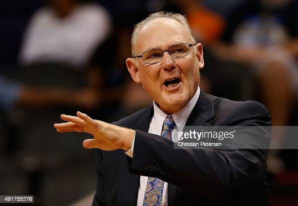 Head coach George Karl of the Sacramento Kings reacts during the second half of the preseason NBA game against the Phoenix Suns at Talking Stick...