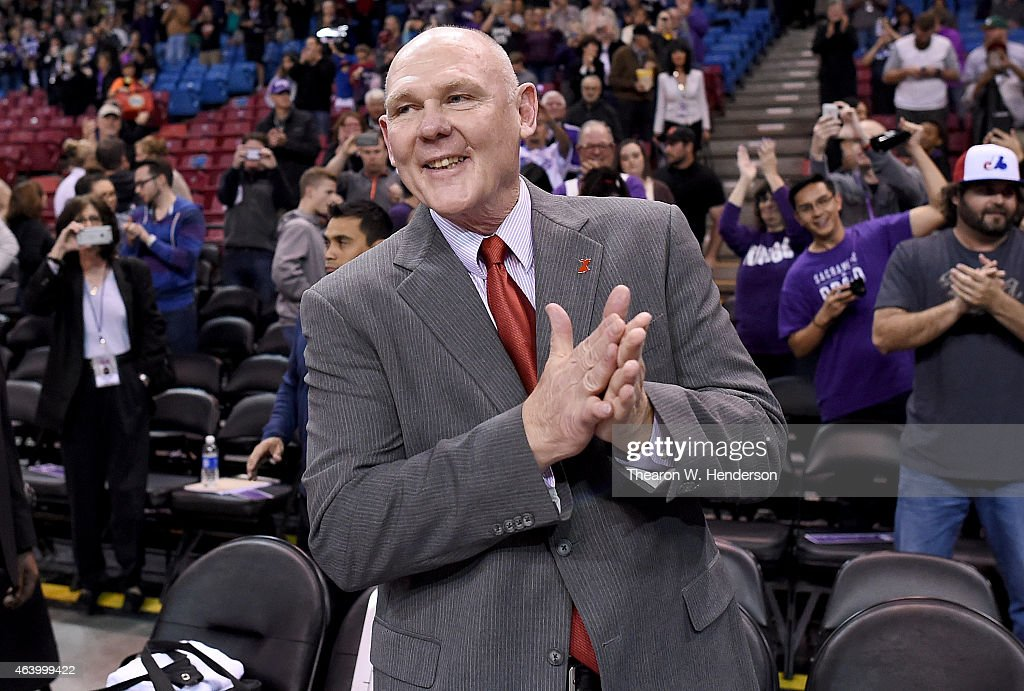 Head coach <a gi-track='captionPersonalityLinkClicked' href=/galleries/search?phrase=George+Karl&family=editorial&specificpeople=204519 ng-click='$event.stopPropagation()'>George Karl</a> of the Sacramento Kings smiles while the fans applauds him prior to the start of the game against the Boston Celtics at Sleep Train Arena on February 20, 2015 in Sacramento, California.