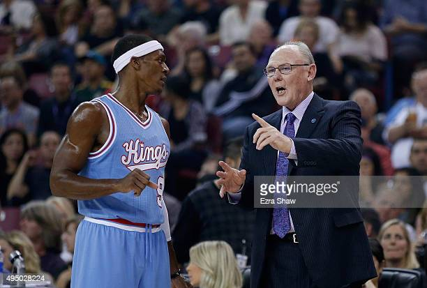 Head coach George Karl of the Sacramento Kings talks to Rajon Rondo of the Sacramento Kings during their game against the Los Angeles Lakers at Sleep...