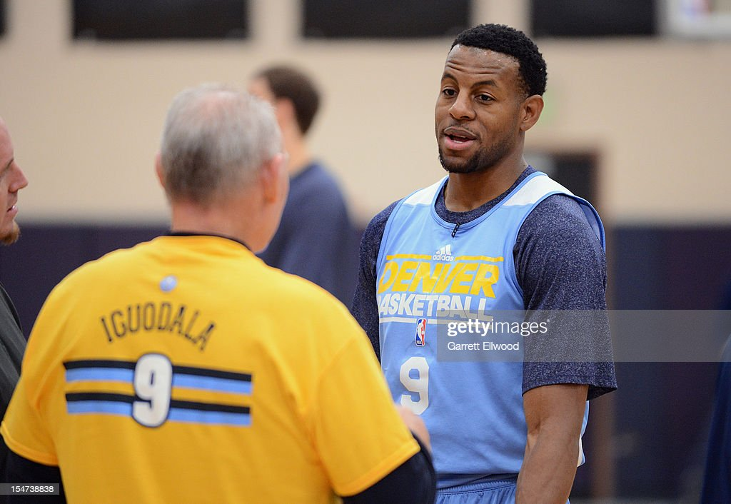 Head Coach George Karl talks with Andre Iguodala #9 of the Denver Nuggets during practice on October 24, 2012 at the Pepsi Center in Denver, Colorado.