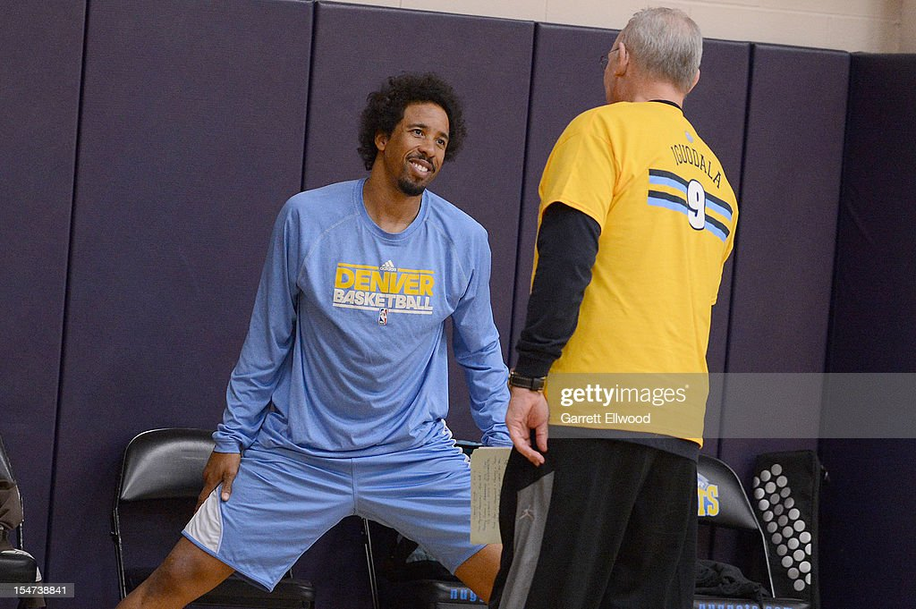 Head Coach <a gi-track='captionPersonalityLinkClicked' href=/galleries/search?phrase=George+Karl&family=editorial&specificpeople=204519 ng-click='$event.stopPropagation()'>George Karl</a> talks with Andre Miller #24 of the Denver Nuggets during practice on October 24, 2012 at the Pepsi Center in Denver, Colorado.