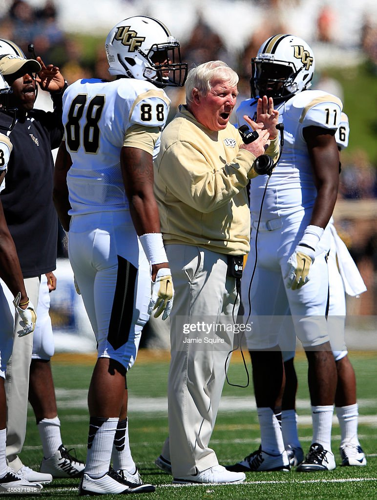 Head coach <a gi-track='captionPersonalityLinkClicked' href=/galleries/search?phrase=George+O%27Leary&family=editorial&specificpeople=2259273 ng-click='$event.stopPropagation()'>George O'Leary</a> of the UCF Knights calls a timeout during the game against the Missouri Tigers at on September 13, 2014 at Faurot Field in Columbia, Missouri.