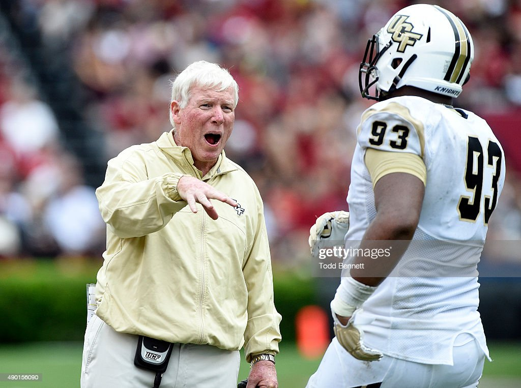 Head coach <a gi-track='captionPersonalityLinkClicked' href=/galleries/search?phrase=George+O%27Leary&family=editorial&specificpeople=2259273 ng-click='$event.stopPropagation()'>George O'Leary</a> talks with defensive lineman Tony Guerad of the University of Central Florida Knights as they take on the South Carolina Gamecocks during the second quarter on September 26, 2015 at Williams-Brice Stadium in Columbia, South Carolina.