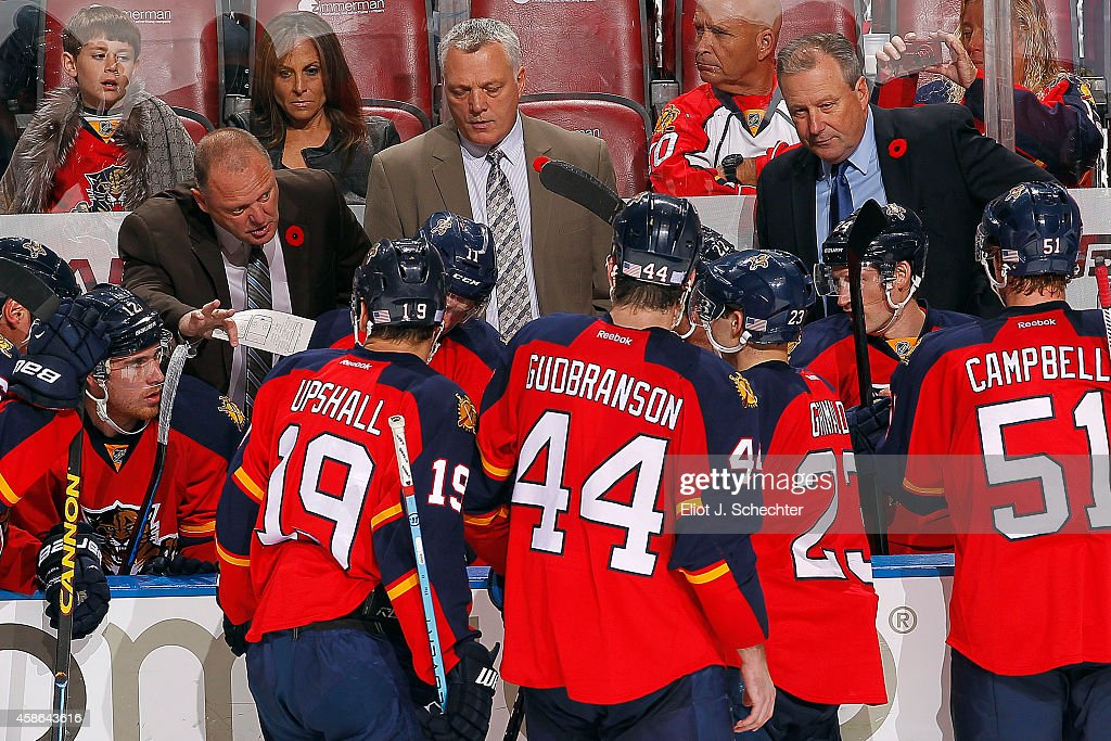 Head Coach Gerald Gallant of the Florida Panthers and Assistant Coaches Mike Kelly and Mark Morris direct their team during a break in the action against the Calgary Flames at the BB&T Center on November 8, 2014 in Sunrise, Florida.