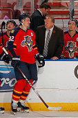 Head Coach Gerald Gallant of the Florida Panthers chats with Tomas Kopecky during a break in the action against the Calgary Flames at the BBT Center...
