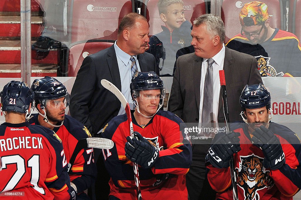 Head Coach <a gi-track='captionPersonalityLinkClicked' href=/galleries/search?phrase=Gerard+Gallant&family=editorial&specificpeople=704668 ng-click='$event.stopPropagation()'>Gerard Gallant</a> of the Florida Panthers chats with Assistant Coach Mike Kelly during a break in the action against the Carolina Hurricanes at the BB&T Center on November 26, 2014 in Sunrise, Florida.