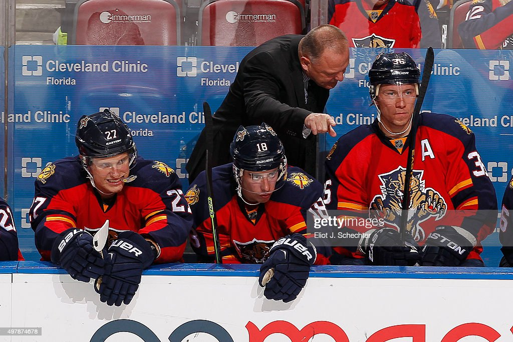 Head Coach <a gi-track='captionPersonalityLinkClicked' href=/galleries/search?phrase=Gerard+Gallant&family=editorial&specificpeople=704668 ng-click='$event.stopPropagation()'>Gerard Gallant</a> of the Florida Panthers chats with <a gi-track='captionPersonalityLinkClicked' href=/galleries/search?phrase=Jussi+Jokinen&family=editorial&specificpeople=570599 ng-click='$event.stopPropagation()'>Jussi Jokinen</a> #36 during a break in the action against the Tampa Bay Lightning at the BB&T Center on November 16, 2015 in Sunrise, Florida.