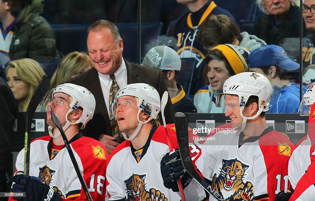 Head coach <a gi-track='captionPersonalityLinkClicked' href=/galleries/search?phrase=Gerard+Gallant&family=editorial&specificpeople=704668 ng-click='$event.stopPropagation()'>Gerard Gallant</a> of the Florida Panthers smiles with players in the closing moments of their 5-1 victory against the Buffalo Sabres in an NHL game on January 5, 2016 at the First Niagara Center in Buffalo, New York.