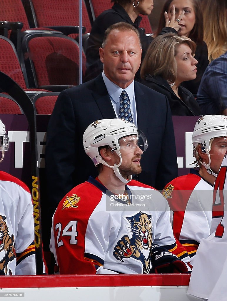 Head coach <a gi-track='captionPersonalityLinkClicked' href=/galleries/search?phrase=Gerard+Gallant&family=editorial&specificpeople=704668 ng-click='$event.stopPropagation()'>Gerard Gallant</a> of the Florida Panthers watches from the bench during the NHL game against the Arizona Coyotes at Gila River Arena on October 25, 2014 in Glendale, Arizona. The Coyotes defeated the Panthers 2-1 in overtime.