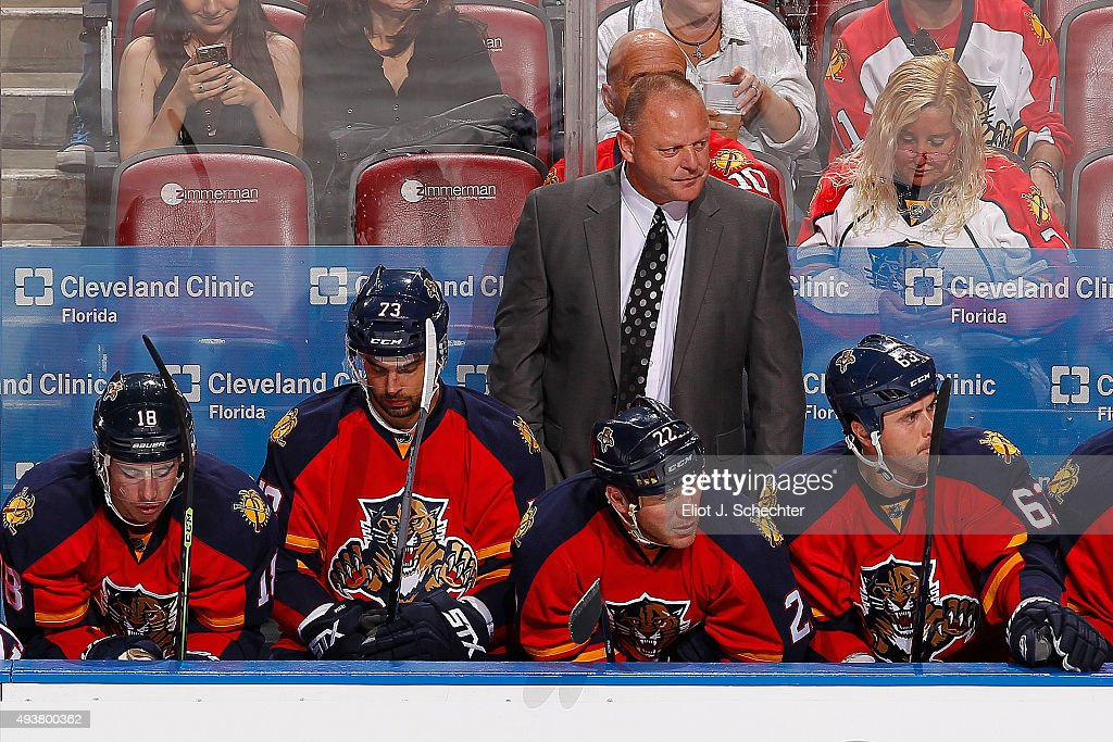 Head Coach <a gi-track='captionPersonalityLinkClicked' href=/galleries/search?phrase=Gerard+Gallant&family=editorial&specificpeople=704668 ng-click='$event.stopPropagation()'>Gerard Gallant</a> of the Florida Panthers watches the action from the bench against the Dallas Stars at the BB&T Center on October 17, 2015 in Sunrise, Florida.
