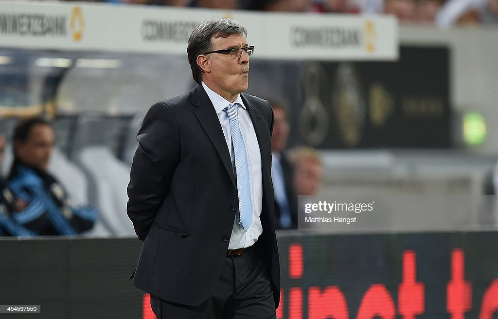 Head coach <a gi-track='captionPersonalityLinkClicked' href=/galleries/search?phrase=Gerardo+Martino&family=editorial&specificpeople=4362047 ng-click='$event.stopPropagation()'>Gerardo Martino</a> of Argentina reacts during the international friendly match between Germany and Argentina at Esprit-Arena on September 3, 2014 in Duesseldorf, Germany.