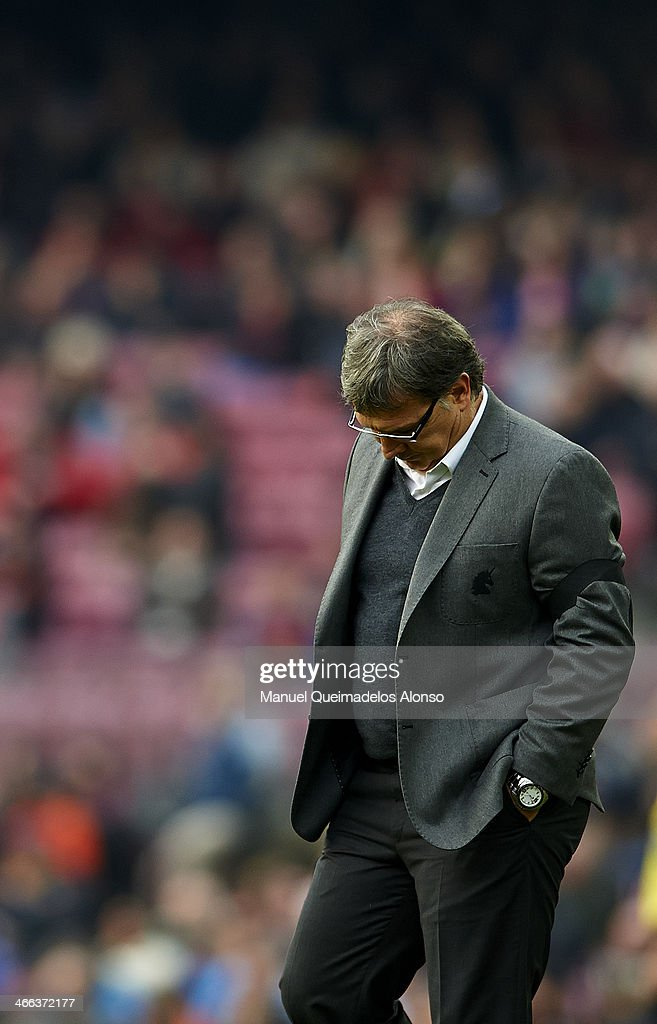 Head coach <a gi-track='captionPersonalityLinkClicked' href=/galleries/search?phrase=Gerardo+Martino&family=editorial&specificpeople=4362047 ng-click='$event.stopPropagation()'>Gerardo Martino</a> of FC Barcelona reacts during the La Liga match between FC Barcelona and Valencia CF at Camp Nou on February 1, 2014 in Barcelona, Spain.