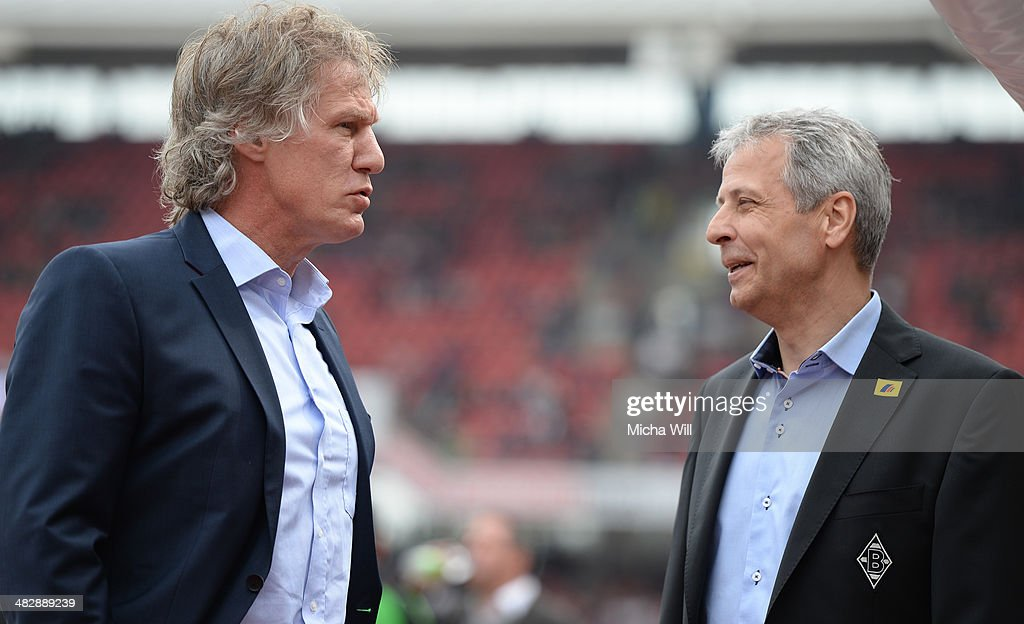 Head coach Gertjan Verbeek of Nuernberg talks to Head coach Lucien Favre of Moenchengladbach prior to the Bundesliga match between 1 FC Nuernberg and...
