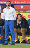 Head coach Gino Lettieri and sports director Ivica Grlic of Duisburg watch their players during the Third League match between MSV Duisburg and...