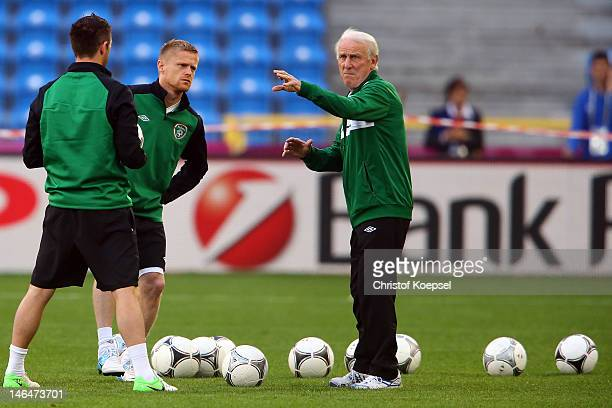 Head coach Giovanni Trapattoni of Ireland issues instructions to Robbie Keane and Damien Duff during a UEFA EURO 2012 training session at the...