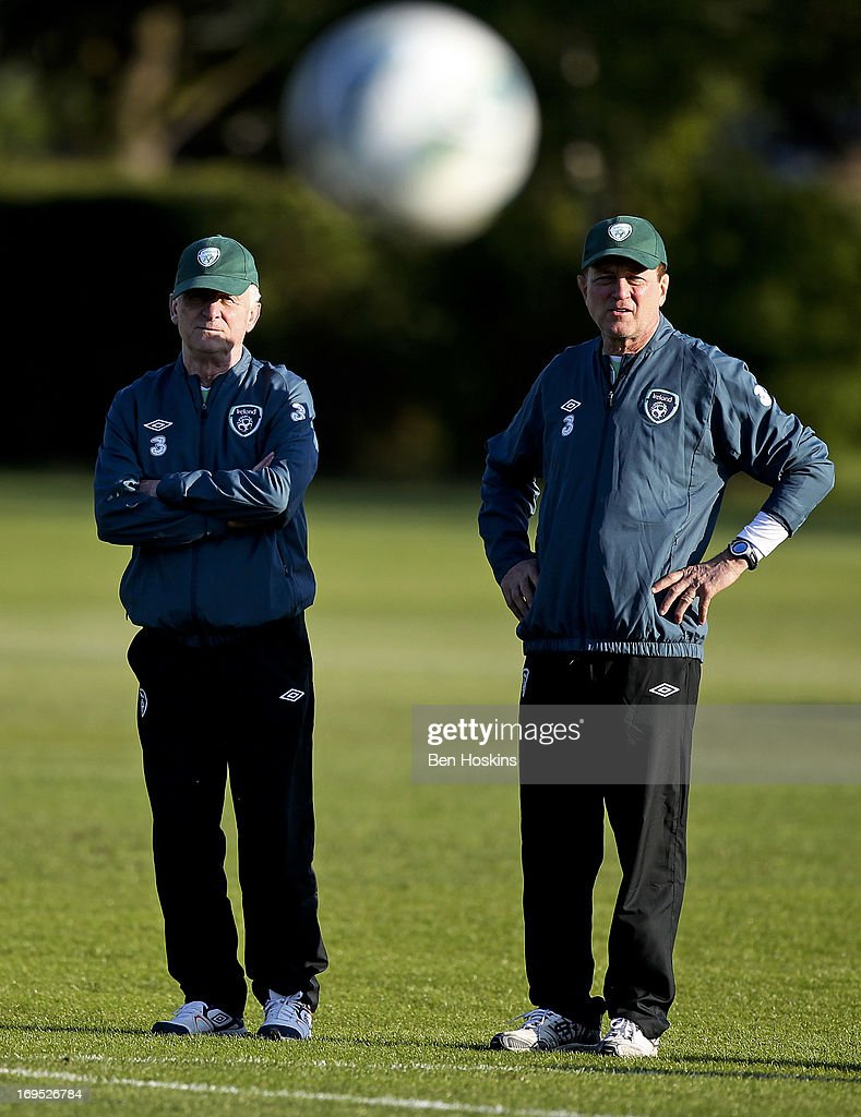 Head coach <a gi-track='captionPersonalityLinkClicked' href=/galleries/search?phrase=Giovanni+Trapattoni&family=editorial&specificpeople=209002 ng-click='$event.stopPropagation()'>Giovanni Trapattoni</a> of the Republic of Ireland (L) oversees an Ireland training session at Watford FC Training Ground on May 26, 2013 near St Albans, London Colney, England.