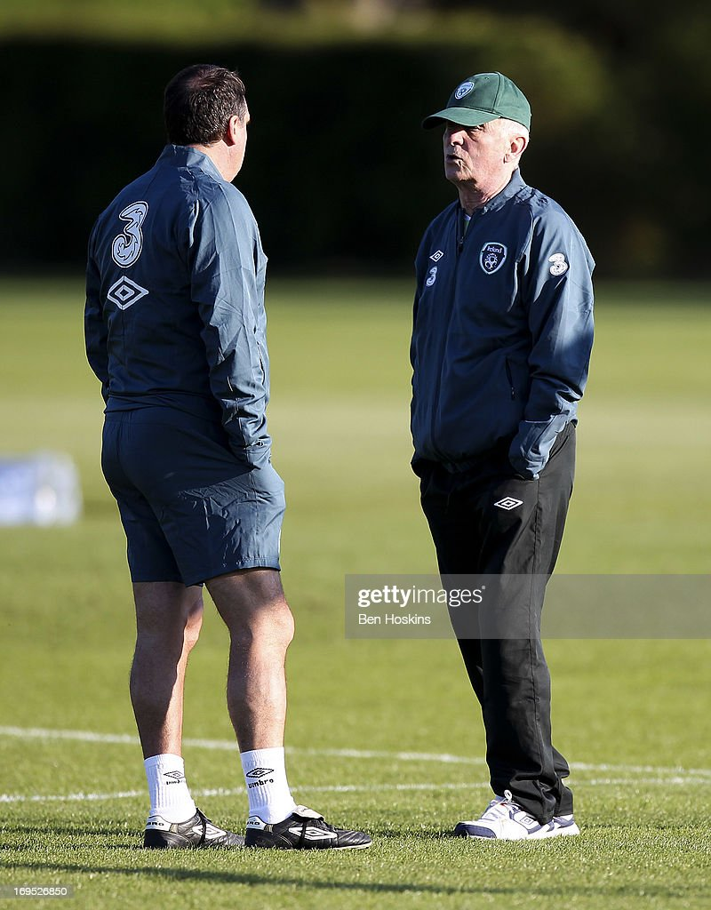 Head coach Giovanni Trapattoni (R) of the Republic of Ireland speaks with a member of his backroom staff during an Ireland training session at Watford FC Training Ground on May 26, 2013 near St Albans, London Colney, England.