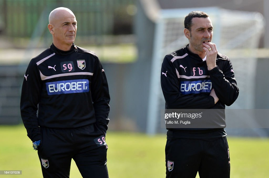 Head coach Giuseppe Sannino and his assistant Francesco Baiano watch the action during a Palermo training session at Tenente Carmelo Onorato Sports Center on March 20, 2013 in Palermo, Italy.
