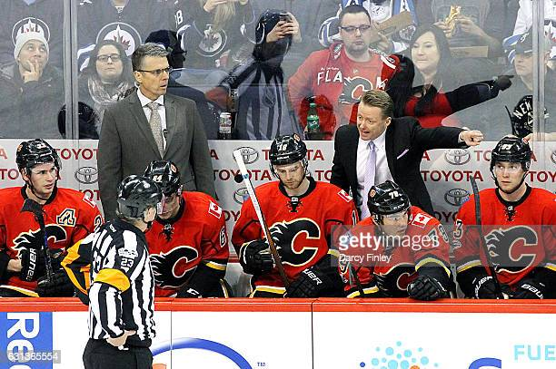 Head Coach Glen Gulutzan of the Calgary Flames argues with referee Brad Watson during a second period stoppage in play against the Winnipeg Jets at...