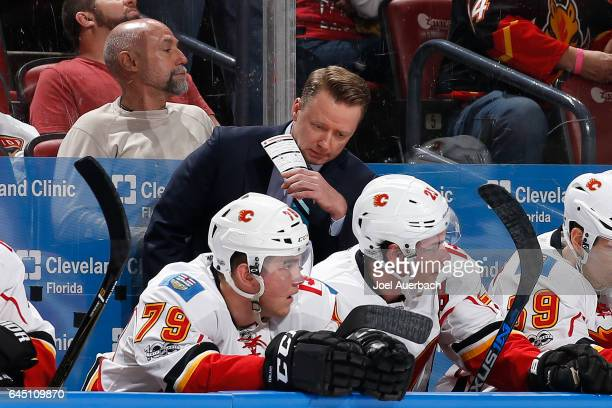 Head coach Glen Gulutzan of the Calgary Flames directs the players during first period action against the Florida Panthers at the BBT Center on...