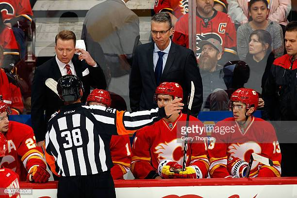 Head coach Glen Gulutzan of the Calgary Flames has a discussion with a referee during an NHL game against the Arizona Coyotes on December 31 2016 at...