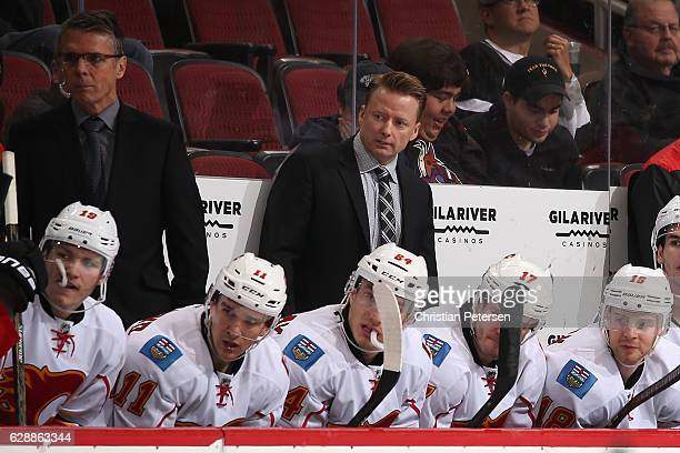 Head coach Glen Gulutzan of the Calgary Flames looks down the bench during the third period of the NHL game against the Arizona Coyotes at Gila River...