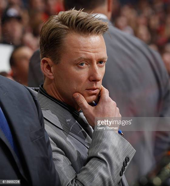Head coach Glen Gulutzan of the Calgary Flames looks on from the bench during the game against the Carolina Hurricanes at Scotiabank Saddledome on...
