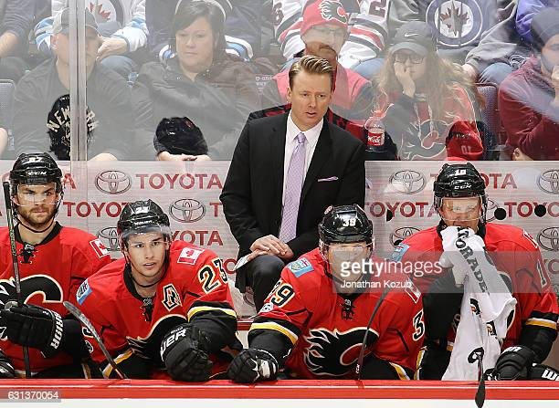 Head Coach Glen Gulutzan of the Calgary Flames looks on from the bench during third period action against the Winnipeg Jets at the MTS Centre on...
