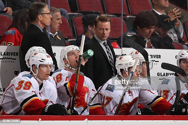 Head coach Glen Gulutzan of the Calgary Flames stands on the bench during the third period of the NHL game against the Arizona Coyotes at Gila River...