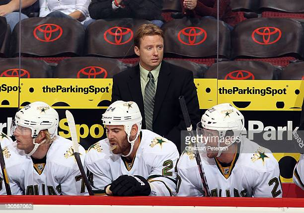 Head coach Glen Gulutzan of the Dallas Stars watches from the bench during the NHL game against the Phoenix Coyotes at Jobingcom Arena on October 25...