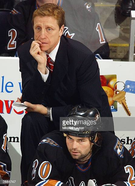 Head coach Glen Hanlon of the Washington Capitals coaches his first game against the Boston Bruins on December 11 2003 at the MCI Center in...