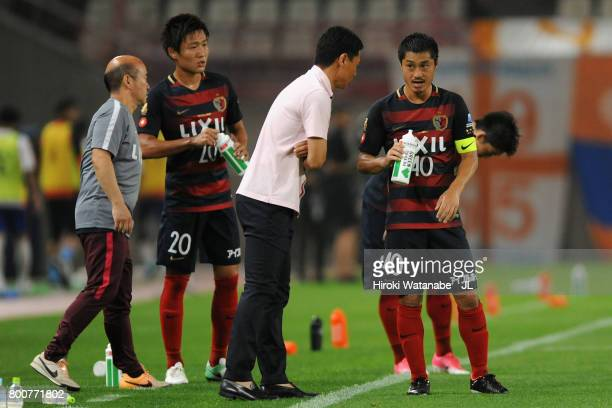 Head coach Go Oiwa gives instruction to Mitsuo Ogasawara of Kashima Antlers during the JLeague J1 match between Kashima Antlers and Albirex Niigata...