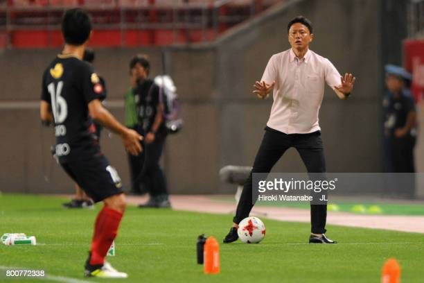 Head coach Go Oiwa of Kashima Antlers gestures during the JLeague J1 match between Kashima Antlers and Albirex Niigata at Kashima Soccer Stadium on...