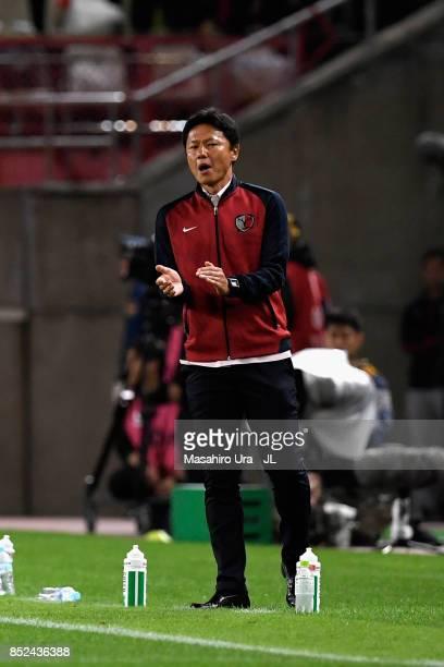 Head coach Go Oiwa of Kashima Antlers gestures during the JLeague J1 match between Kashima Antlers and Gamba Osaka at Kashima Soccer Stadium on...