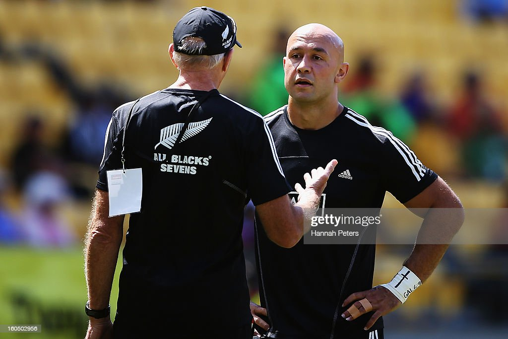 Head coach Gordon Tietjens of the All Blacks Sevens talks to DJ Forbers ahead of the quarterfinal cup match between New Zealand and Australia during the 2013 Wellington Sevens at Westpac Stadium on February 2, 2013 in Wellington, New Zealand.