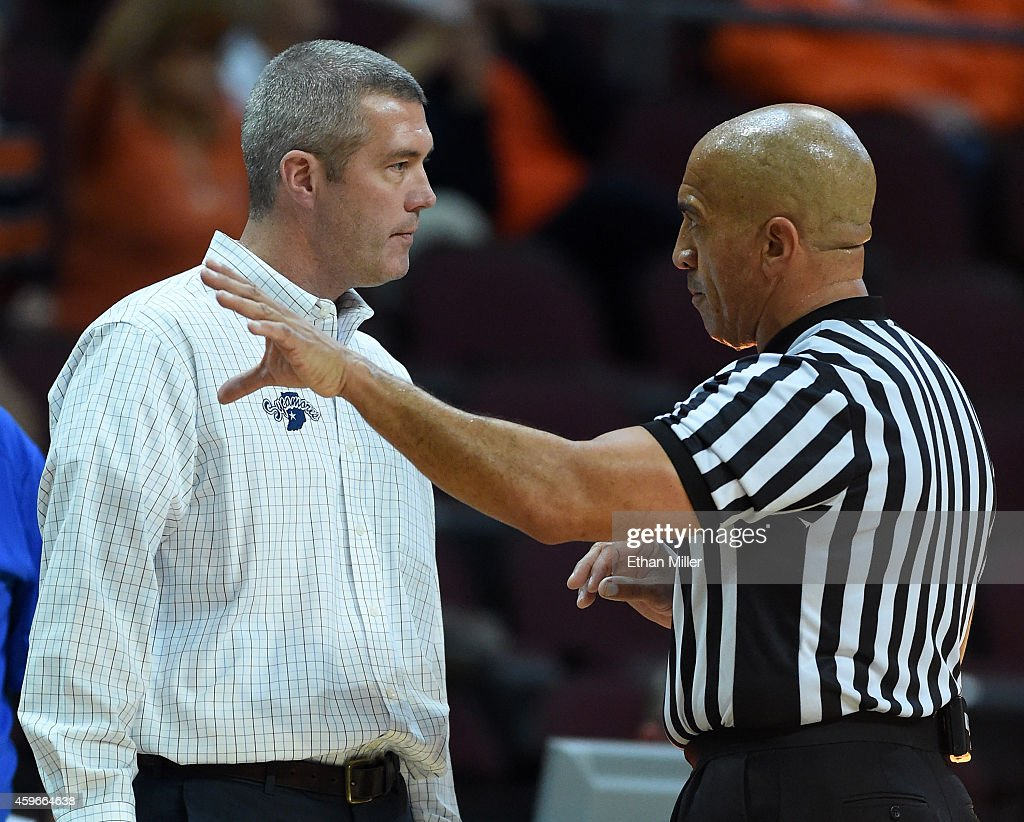 Head coach Greg Lansing of the Indiana State Sycamores talks to an official after players from Lansing's team and the Illinois Fighting Illini got...