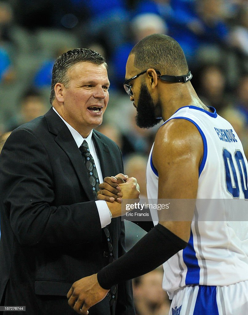 Head coach Greg McDermott of the Creighton Bluejays congratulates Gregory Echenique #0 of the Bluejays as he leaves the game against the Saint Joseph's Hawks at CenturyLink Center on December 1, 2012 in Omaha, Nebraska. Creighton defeated Saint Joseph's 80-51.