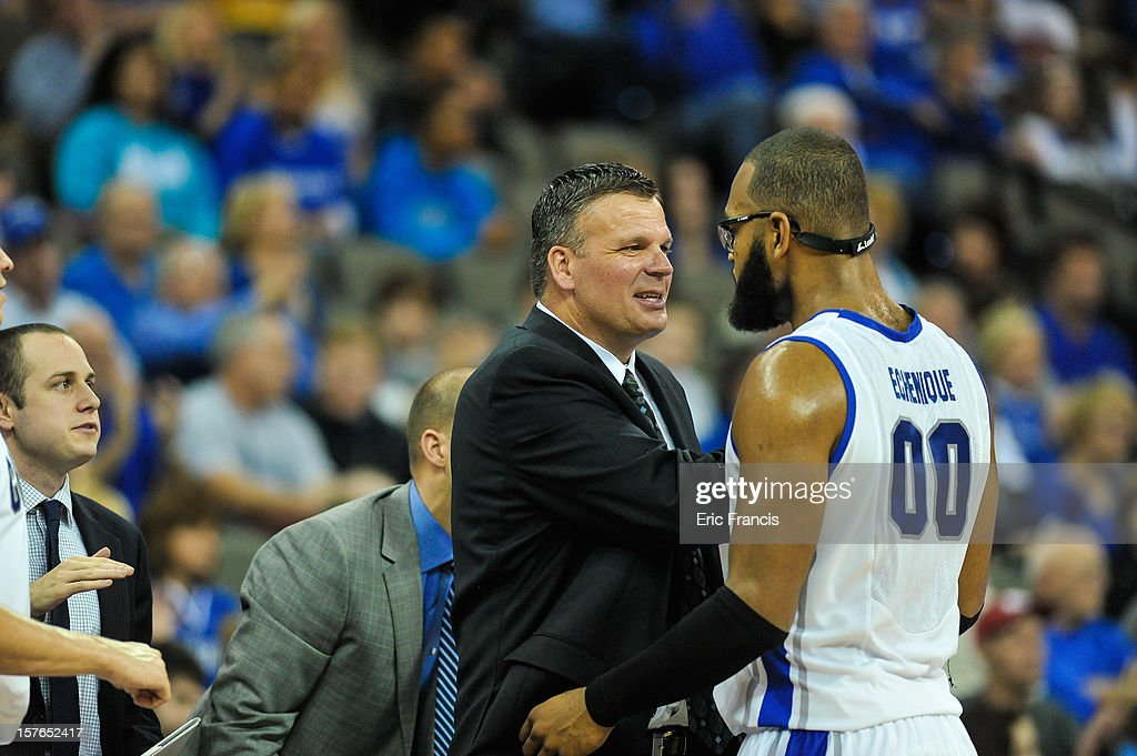 Head coach Greg McDermott of the Creighton Bluejays congratulates Gregory Echenique #0 of the Creighton Bluejays as he leaves the game against the Saint Joseph's Hawks at CenturyLink Center on December 1, 2012 in Omaha, Nebraska. Creighton defeated Saint Joseph's 80-51.