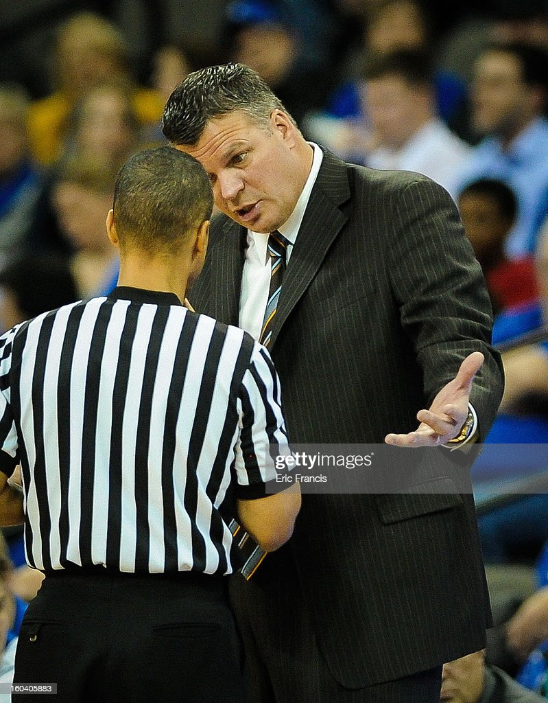 Head coach Greg McDermott of the Creighton Bluejays discusses a call with officials during their game at against the Missouri State Bears the CenturyLink Center on January 30, 2013 in Omaha, Nebraska.