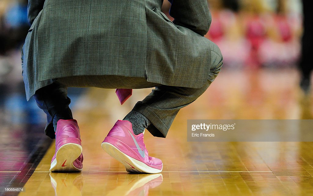Head coach Greg McDermott of the Creighton Bluejays sports pink shoes during their game against the Bradley Braves at the CenturyLink Center on February 2, 2013 in Omaha, Nebraska. Saturday's game was the Creighton Bluejays annual pink out in support of breast cancer awareness.